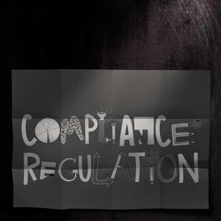 compliant:   Compliance Regulation design words on dark crumpled paper as concept