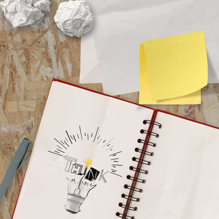 note book with hand drawn light bulb and THINK word design as concept photo