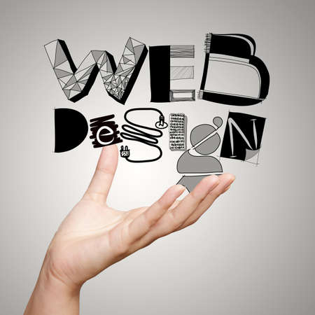 clouse up of  hand showing design word WEB DESIGN  as concept photo