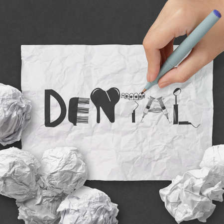 hand drawing design word DENTAL on white crumpled paper and texture background as concept Stock Photo