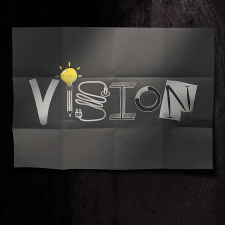 hand drawn VISION design word on crumpled paper background as concept photo