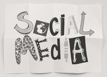 hand drawn social media icons on crumpled paper background as concept photo