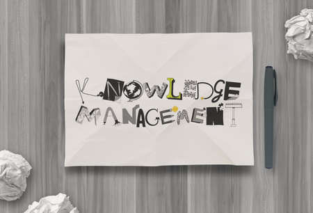 insights: design word KNOWLEDGE MANAGEMENTon crumpled paper as concept