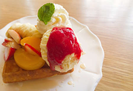 Waffle with fruits on wooden table