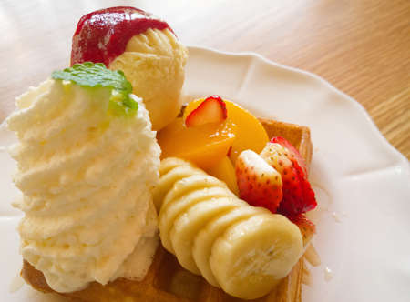 sou: Waffle with fruits on wooden table