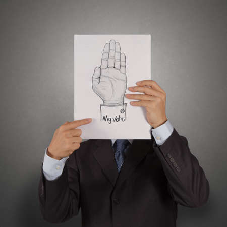businessman show book of  Hand raised with MY VOTE text as concept photo