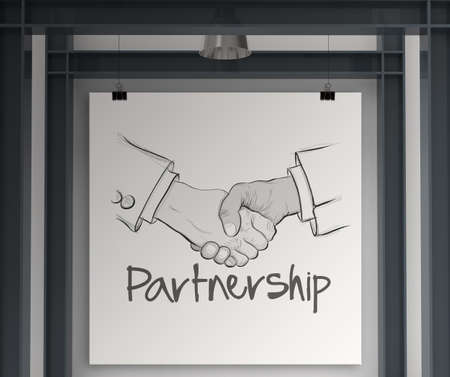 hand drawn handshake sign on art borad as partnership business concept photo