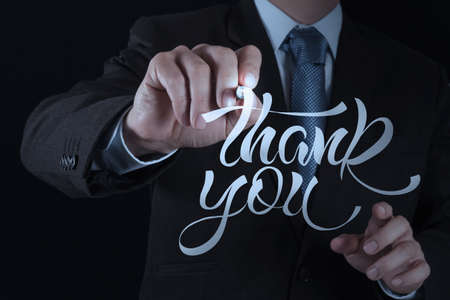 businessman hand drwing design word THANK YOU photo
