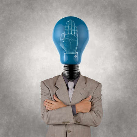businessman with lamp-head  and hand rised sign as concept photo