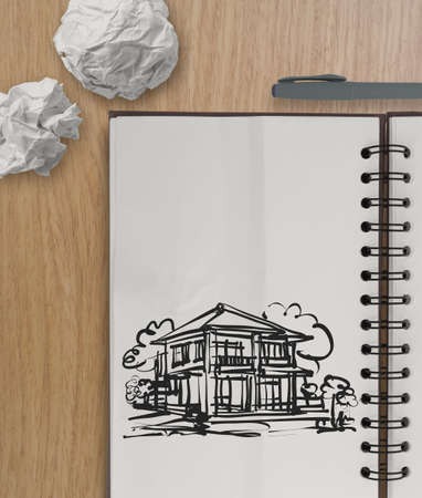 hand drawing house on wrinkled paper with wooden table as concept  photo