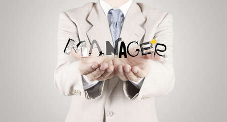 businessman hand showing design graphic word MANAGER as concept photo