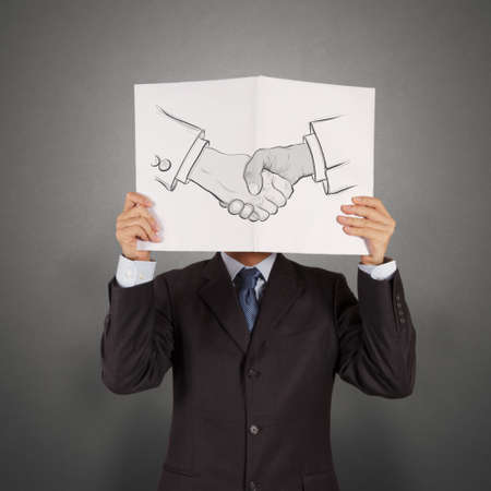 book of hand drawn handshake sign as partnership business concept photo