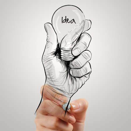 Hand drawn light bulb with IDEA word on white board as concept photo