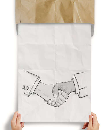 hand drawn handshake sign on crumpled paper as partnership business concept photo