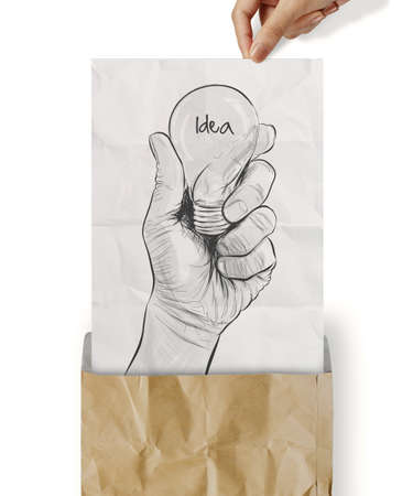 Hand drawn light bulb with IDEA word on crumpled paper as concept photo