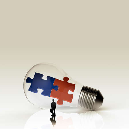 Light bulb and two puzzles with businessman as partnership concept  photo