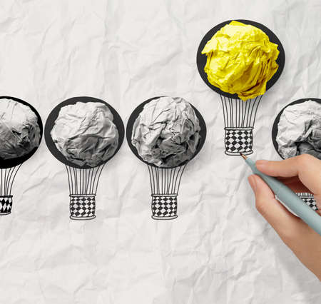 hand drawn air balloons with crumpled paper ball as leadership concept photo