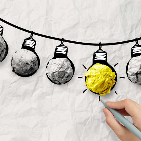 best ideas: hand drawn light bulb on wire doodle with crumpled paper as leadership idea concept Stock Photo