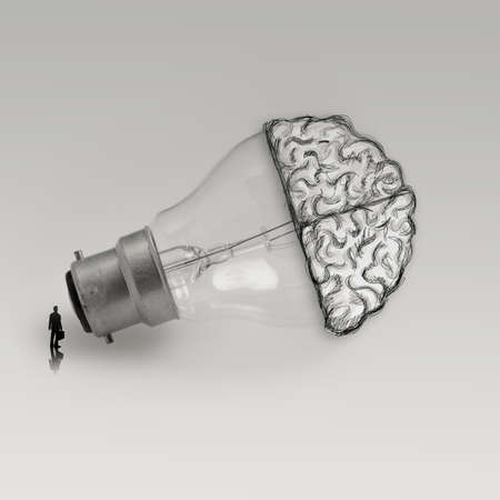 businessman looking at Light bulb with hand drawn brain as creative idea concept  photo