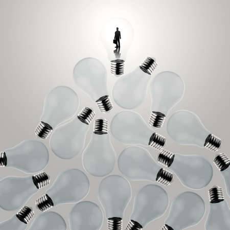 businessman standing at 3d growing light bulb standing out from the unlit incandescent bulbs as leadership concept photo
