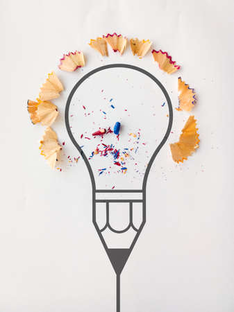 graphic pencil  light bulb with pencil saw dust on paper as creative concept photo