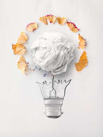 sharpen: hand drawn light bulb and crumpled paper with pencil saw dust on paper as creative concept