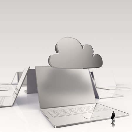 synchronizing: businessman looking at Cloud computing 3d sign on laptop computer as concept  Stock Photo