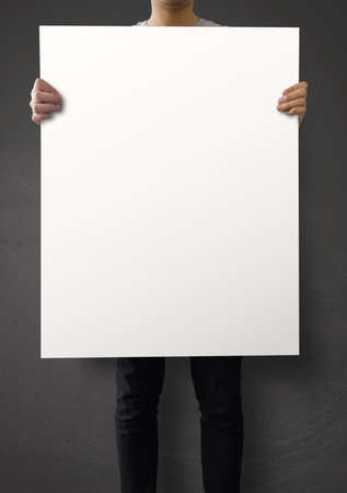 hipster holding blank poster on texture wall as concept  photo