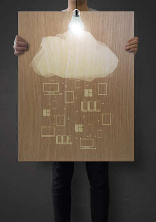man showing poster of graphic cluod network diagram on wooden board as concept photo