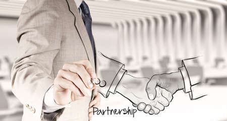 hand drawn handshake sign as partnership business concept photo
