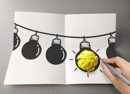 hand drawn light bulb on wire doodle with crumpled paper as leadership idea concept photo