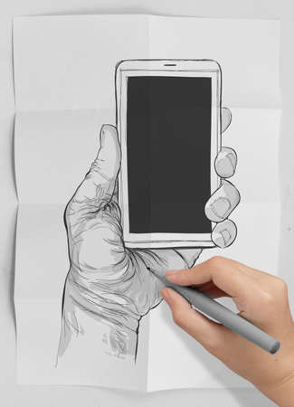 Hand drawn hands with mobile phone on crumpled paper as concept photo