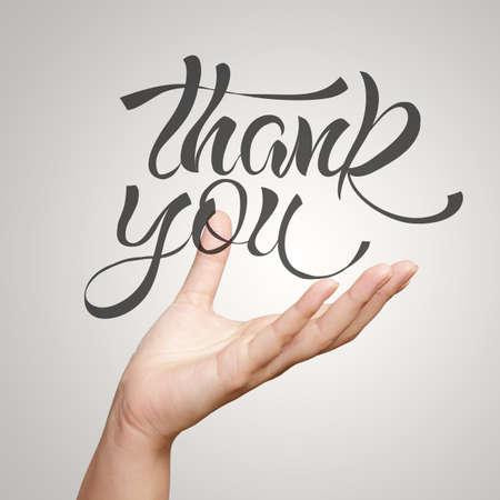 thankful: hand showing hand drawn design word THANK YOU as concept