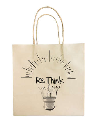 Hand drawn light bulb with RETHINK word paper recycle bag on white as concept photo