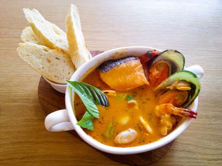 seafood soup: Delicious mediterranean seafood soup on wooden table Stock Photo