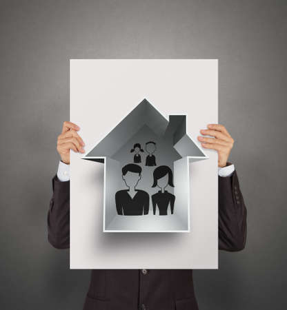 family relationships: businessman show hand draw family and house on poster as insurance concept