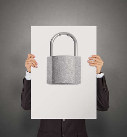 metal shield: businessman hand showing poster of 3d metal padlock as security concept