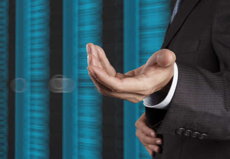 businessman hand  and server room background as concept  photo