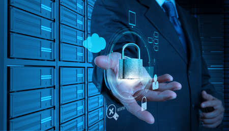 online safety: businessman hand showing 3d padlock on touch screen computer as Internet security online business concept