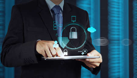 online safety: businessman hand pointing to padlock on touch screen computer as Internet security online business concept