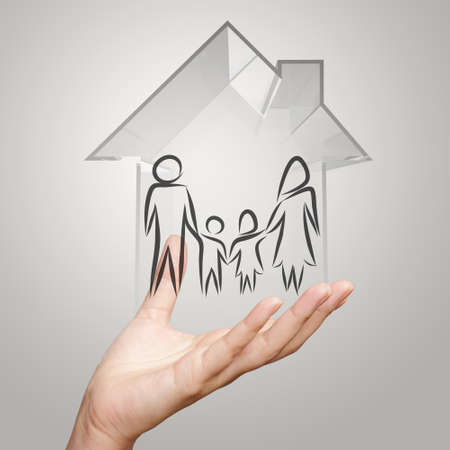 hand holding 3d house wtih family icon as insurance concept photo