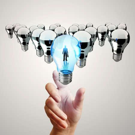 hand reach 3d light bulb of leadership concept Stock Photo