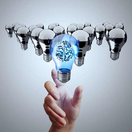 metal light bulb icon: hand reach 3d metal brain inside  light bulb of leadership concept  Stock Photo