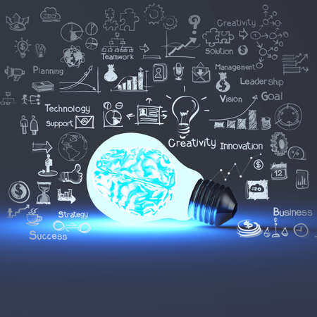 metal light bulb icon: 3d meatal brain inside light bulb and drawing business strategy as concept  Stock Photo
