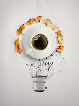 hand drawn light bulb with pencil saw dust and 3d cup of coffee on paper background as creative concept  photo