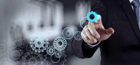 business concept: businessman hand draws gear to success concept