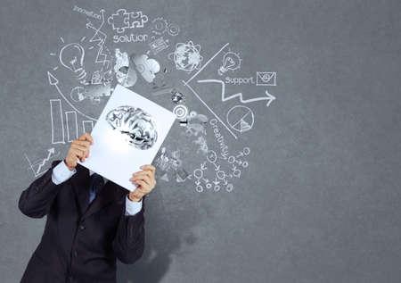 businessman hand show book of 3d metal brain as concept  photo