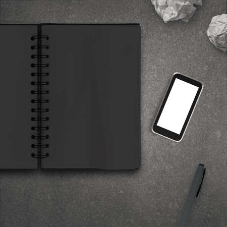 communicative: blank 3d mobile phone with blank note book on stone desk as concept