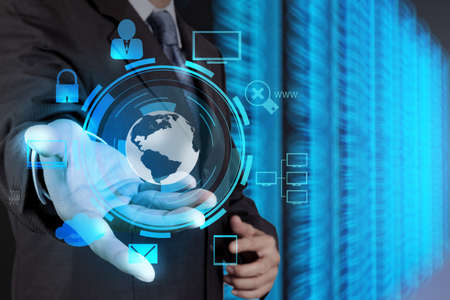 businessman hand holding cloud network icon on touch screen computer as Internet security online business concept  photo