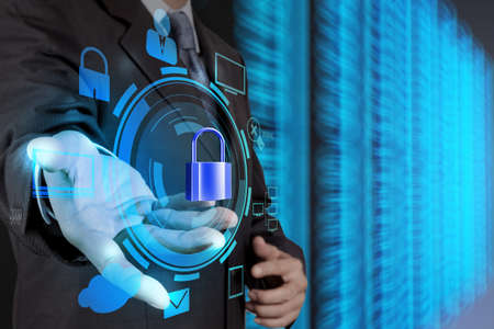 businessman hand showing 3d padlock on touch screen computer as Internet security online business concept  photo